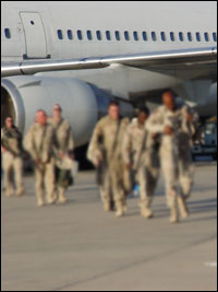 military people getting off plane